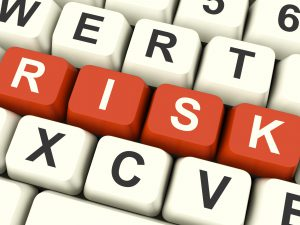 Risk Computer Keys In Red Showing Peril And Uncertainty